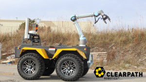 Here, Robotiq grippers are seen on the end of a robotic arm made by Universal Robots, placed on top of a robotic vehicle made by Clearpath Robotics