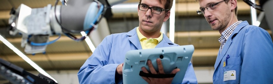 Siemens provides close-up view of its electronics manufacturing plant, where the lines between human and robot workers are blurred
