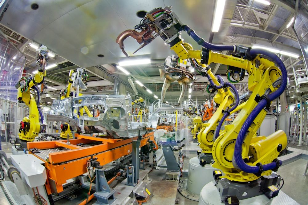 A Fanuc robot in an automotive manufacturing plant