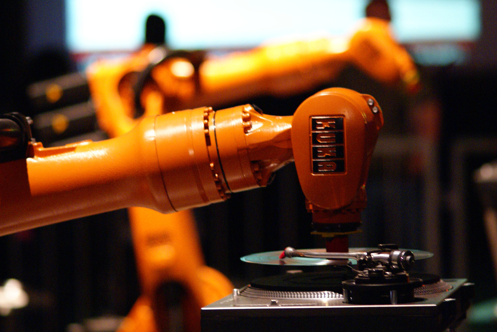 industrial robot playing a vinyl record