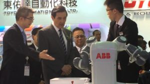 Taiwan's president, Ma Ying-jeou, viewing the ABB YuMi collaborative robot at a previous event