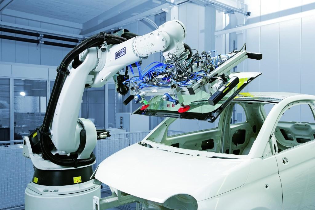 A Dürr industrial robot glues a window onto a Fiat car