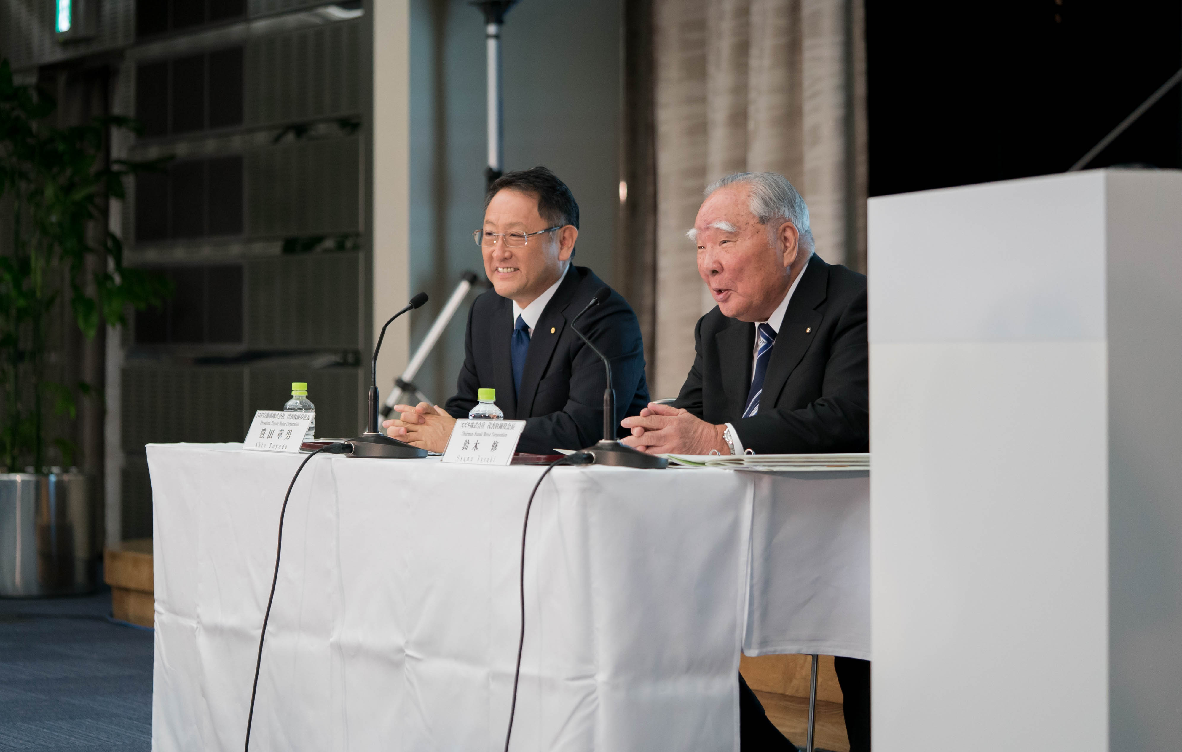 Toyota's president, Akio Toyoda, and Suzuki's chairman, Osamu Suzuki, at the press conference
