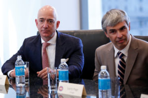 Amazon CEO Jeff Bezos and Larry Page, CEO and co-founder of Alphabet, sit during a meeting with President-elect Donald Trump and technology leaders at Trump Tower. Reuters/Shannon Stapleton