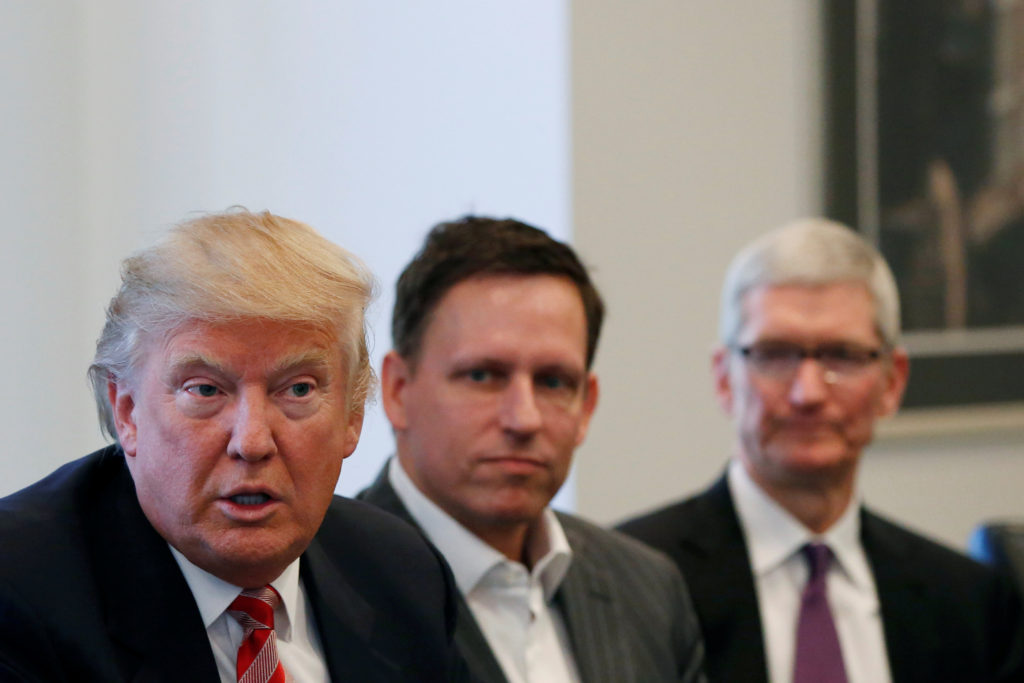 Trump speaks as Thiel and Cook look on. Reuters/Shannon Stapleton