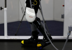 A model demonstrates Toyota Motor Corp's rehabilitation robot Welwalk WW-1000, designed to aid in the rehabilitation of individuals with lower limb paralysis, in Tokyo