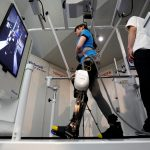 A model demonstrates Toyota's rehabilitation robot Welwalk WW-1000. Reuters / Toru Hanai