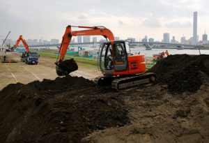 FILE PHOTO: Excavators are seen at a construction site in Tokyo