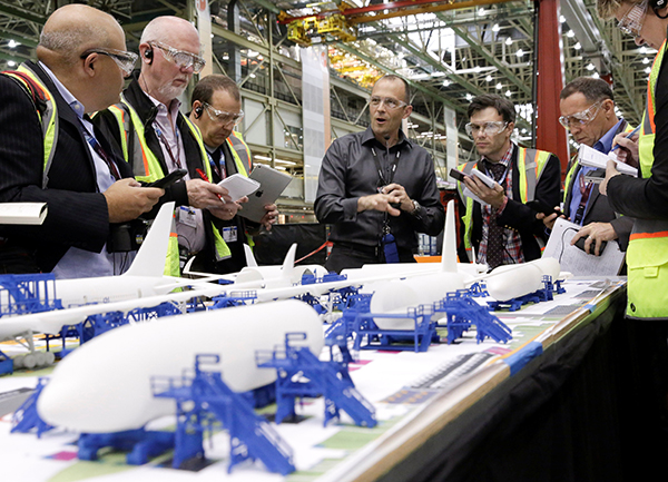 Jason Clark, Vice President of Boeing 777 and 777X Operations, points to a model during a media tour of the 777 Wing Horizontal Build Line at Boeing's production facility in Everett, Washington, US. June 1, 2017. Reuters / Jason Redmond