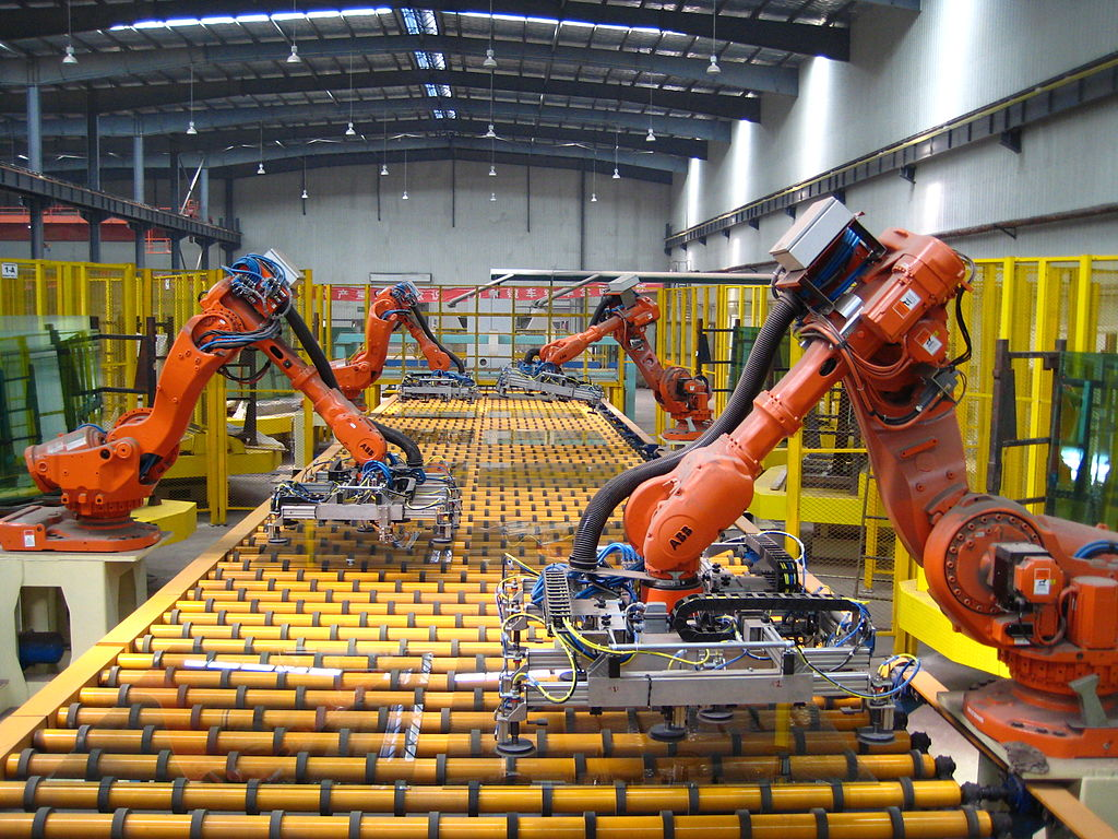 industrial robots moving glass
