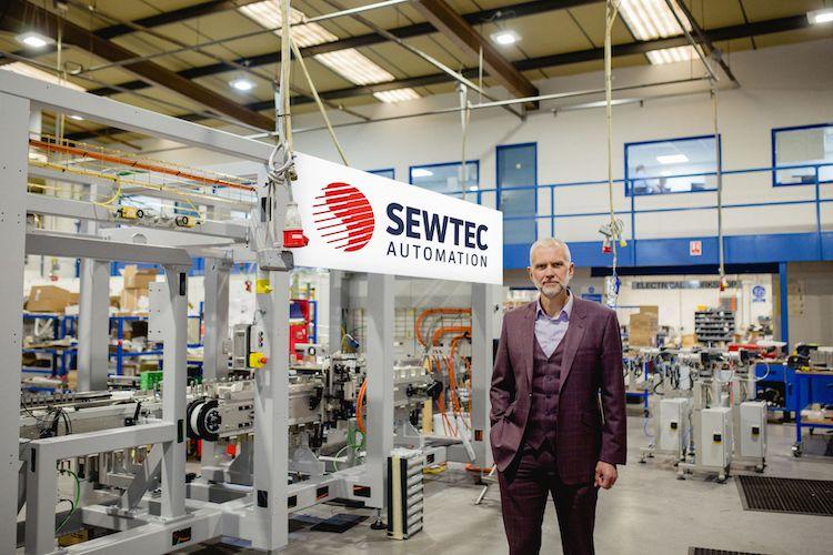 Sewtec managing director, Mark Cook, with Tata Global Beverages' new Tetley fruit tea packaging machine