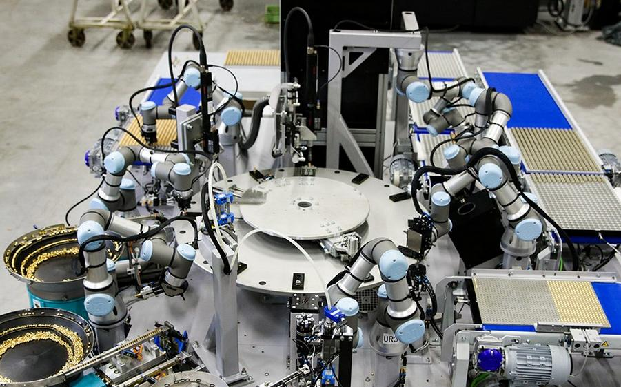 Universal Robots go to work making oil burner parts