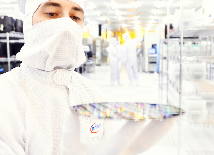 infineon Man with Wafer in Cleanroom copy